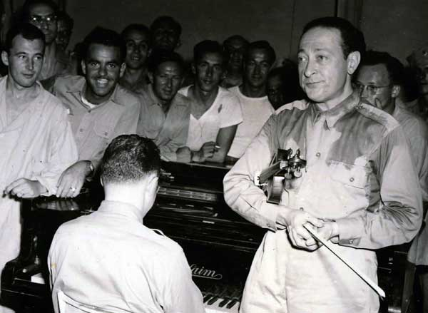 Violinist Jascha Heifetz (at right in photo) felt one of his greatest performances ever was for a single U.S. soldier during World War II.