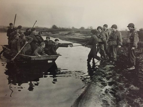 Germans rowing the Elbe River to surrender to the 335th Regiment, 84th Division